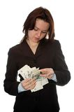 Girl considers the  money. The girl in a business suit considers money. Isolate on white Stock Image