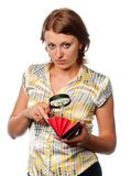 Girl considers a purse through a magnifier Stock Images