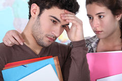 Girl consoling fellow student Stock Photos
