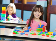 Girl With Construction Block While Friend Playing Royalty Free Stock Images