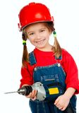 Girl in the construction helmet with a drill Stock Images