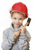 Girl in the construction helmet with a hammer. Stock Photos