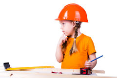 Girl in the construction helmet Stock Photos