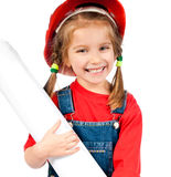 Girl in the construction helmet with poster Royalty Free Stock Photography