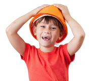 Girl in the construction of protective helmet Stock Photos