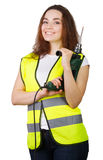 The girl in a construction vest with an electric drill in hands. Stock Photo
