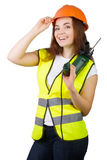 The girl in a construction vest and a helmet with an electric drill. Stock Images