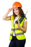 The girl in a construction vest and a helmet with an electric drill. Royalty Free Stock Image