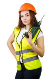 The girl in a construction vest and a helmet with an electric drill. Royalty Free Stock Images