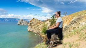 Girl contemplates the beauty of the nature. Cinemagraph, time lapse. Girl contemplates the beauty of the Baikal nature. Cinemagraph, time lapse stock footage