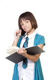 Girl contemplates about a book. Royalty Free Stock Photo