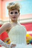 Girl contestant wedding hairstyle. ORENBURG - 6 December: Girl contestant wedding hairstyle 6 December 2014 in ORENBURG, ORENBURG region, RUSSIA Royalty Free Stock Photo