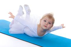 Girl contortionist lies on the gymnastic Mat Stock Image