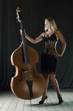 The girl and a contrabass Royalty Free Stock Photography