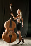 The girl and a contrabass Royalty Free Stock Images