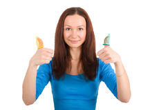Girl with contraceptive. Young woman with yellow condoms isolated Stock Photo
