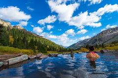 Girl in Conundrum Hot Springs. Woman relaxing in hot spring pool Conundrum Hot Springs near Aspen Colorado Royalty Free Stock Image