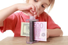 Girl converts one money into other Stock Photo