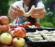 Girl cook apple croissants with own apples from garden Stock Photo