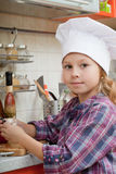 Girl in a cook cap Royalty Free Stock Photo