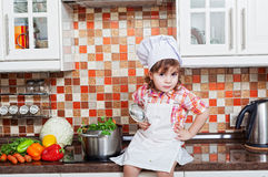 Girl in a cook cap Stock Images