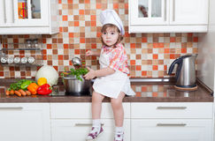 Girl in a cook cap Stock Photography