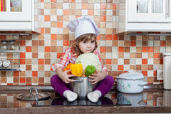 Girl cook with fresh vegetables Stock Image