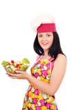 Girl cook holding dish with salad Stock Photo
