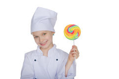Girl cook with lollipop Stock Images