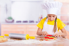 Girl cook makes dough cookies Stock Photo