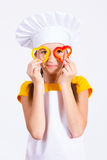 Girl cook near eyes keeps cut peppers Stock Images