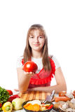 Girl the cook offers a tomato Stock Photos