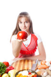 Girl the cook offers a tomato stock image