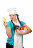 Girl cook and products on white background Royalty Free Stock Photography