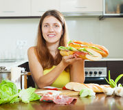 Girl with cooked  spanish sandwiches Royalty Free Stock Photography