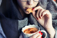 Girl with cookie and tea Royalty Free Stock Photography