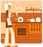 Girl cooking. Beautiful housewife cooking in the kithen Stock Photos