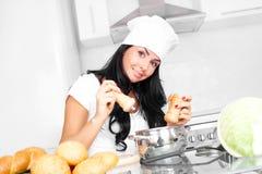Girl cooking Stock Photos
