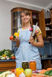 Girl cooking. In the kitchen Royalty Free Stock Photos
