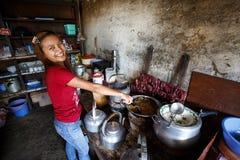 Girl cooking Burmese food in Falam, Myanmar (Burma) Royalty Free Stock Photo