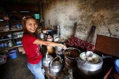 Girl cooking Burmese food in Falam, Myanmar (Burma) Stock Photo