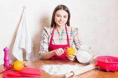 Girl cooking cake in kitchen Stock Photo