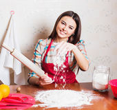 Girl cooking cake in kitchen Royalty Free Stock Image