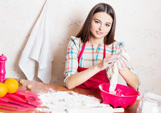 girl cooking cake in kitchen Stock Photography