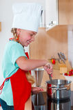 Girl cooking Royalty Free Stock Image