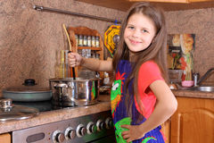 Girl cooking dinner Royalty Free Stock Photos