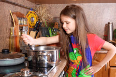 Girl cooking dinner Stock Image