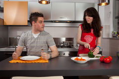 Girl Cooking For A Hungry Guy. Royalty Free Stock Images