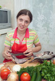 Girl is cooking a fresh  fish Royalty Free Stock Photography