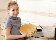 Girl cooking pancakes Royalty Free Stock Image